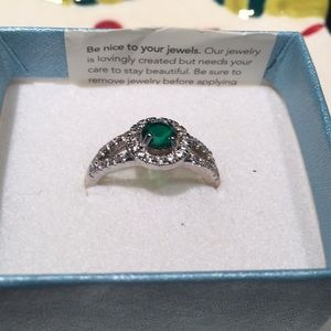 Emerald stone surround by crystal